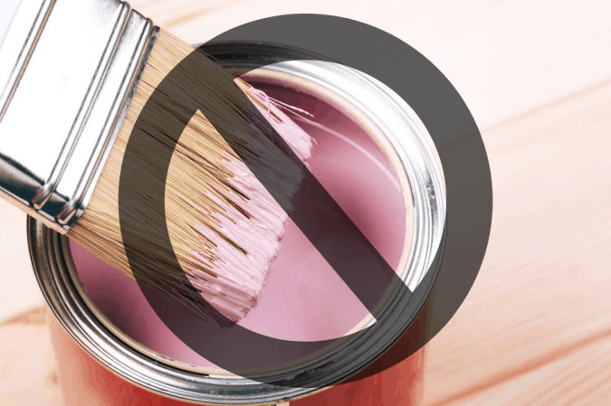 image of a paint brush and paint can with a no symbol for a furniture painting tips