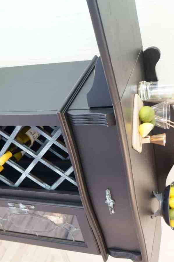 image of a refinished drop leaf wine bar painted in black with patina metal accents