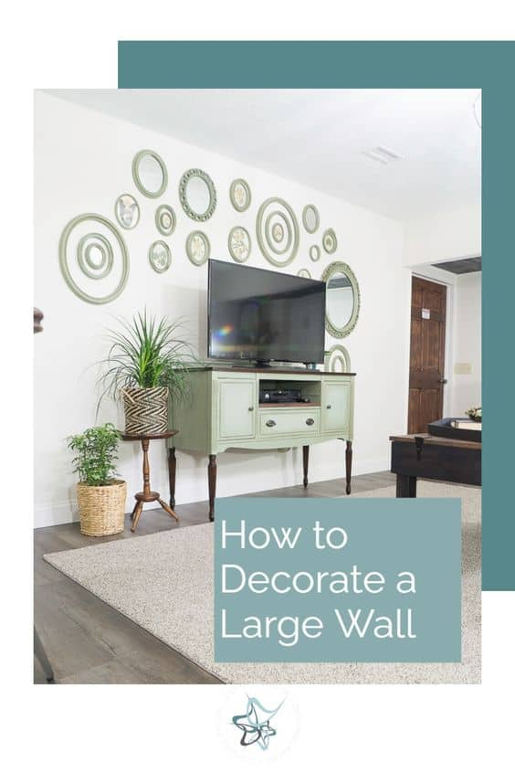 image of a media center with oval wall decor hanging above it to show hoe to decorate a large wall
