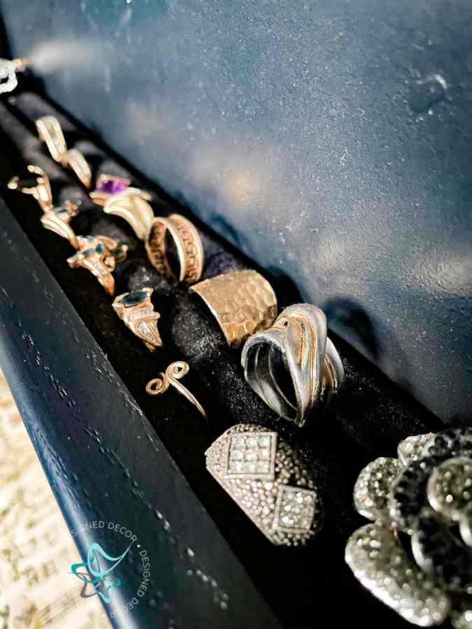 close up image of rings in a black velvet foam ring holder