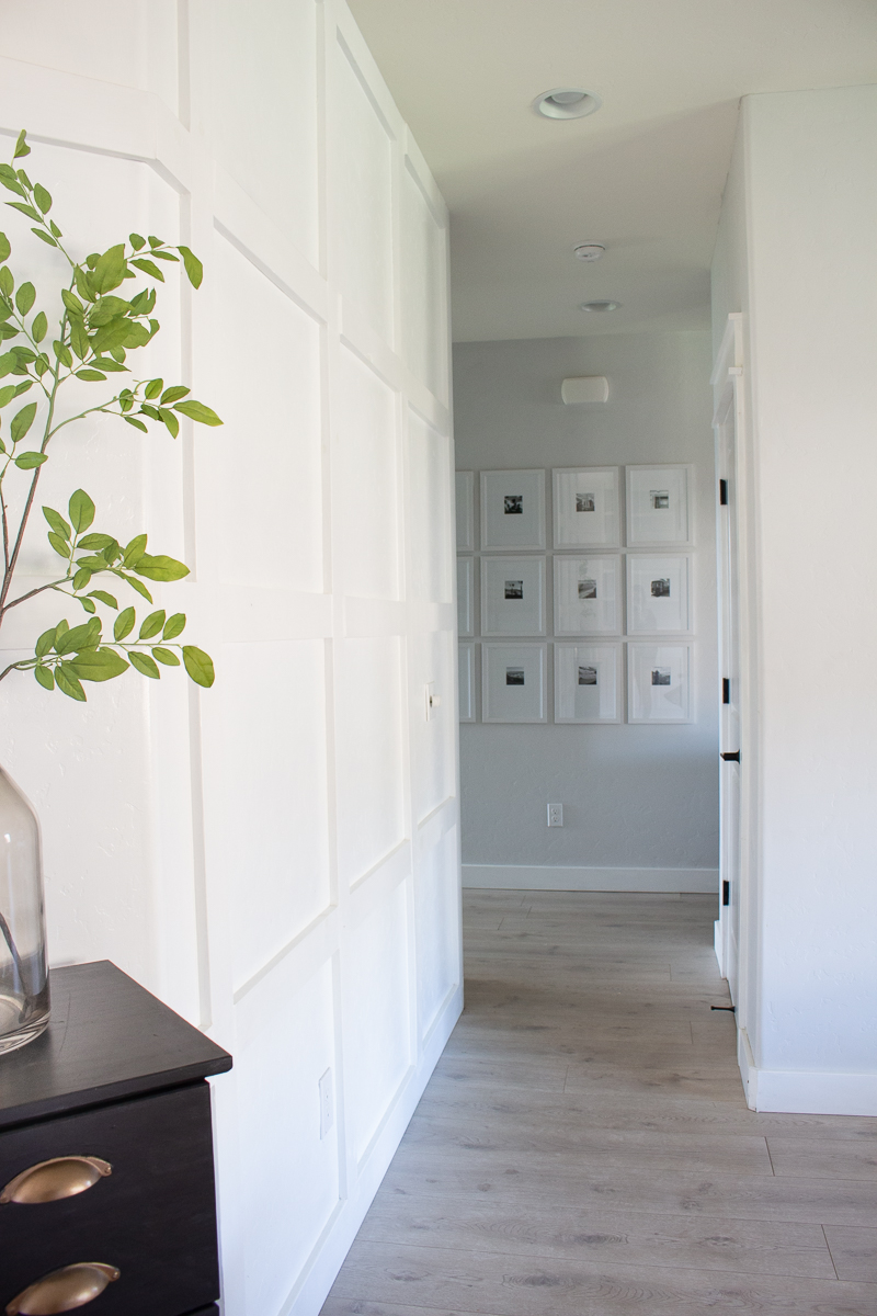 From replacing the flooring, to a new front door, and many wall treatments - I'm sharing some of my favorite DIY projects in our home! | Designed Simple | designedsimple.com