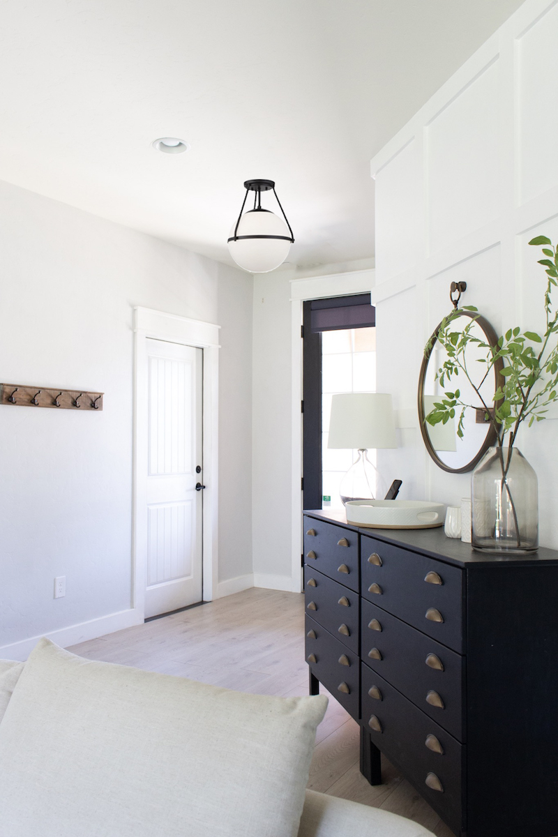 A whole house lighting design will make a home feel cohesive. I've made several lighting choices in our home & I'm sharing all the details! | Designed Simple | designedsimple.com