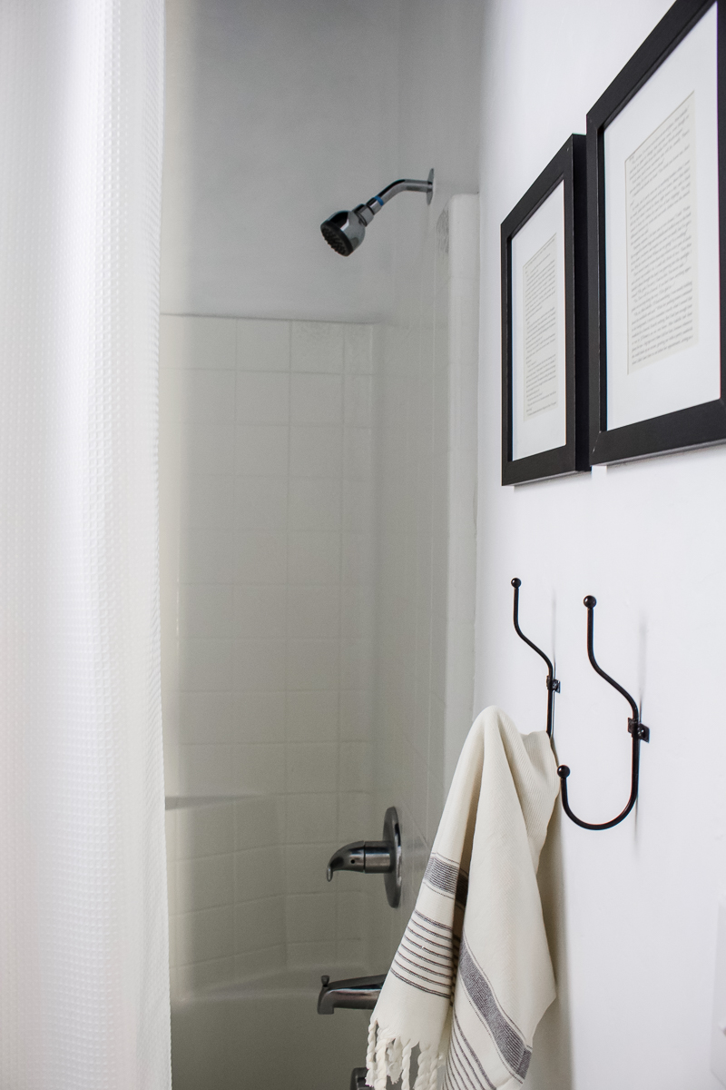 Easily update your builder grade shower surround with a long shower curtain! | Designed Simple | designedsimple.com