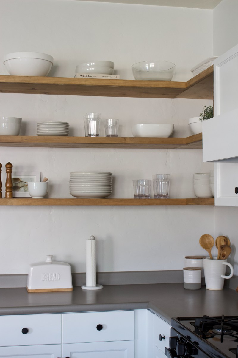 Sturdy, affordable and perfect for everyday use - sharing the tutorial for the DIY floating corner shelves in our kitchen step by step! | Designed Simple | designedsimple.com