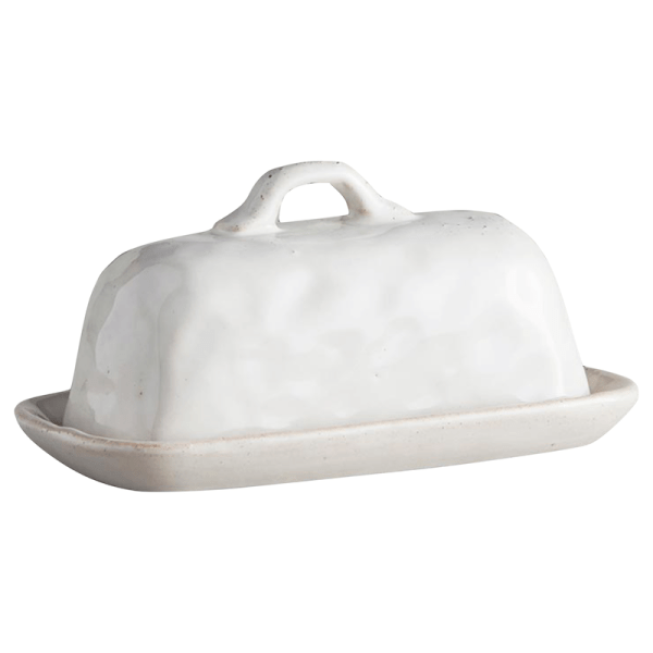 SHOP NOW! This white porcelain glazed butter dish is useful & stylish. With the unique look of handmade, it's perfect for any kitchen! | Designed Simple