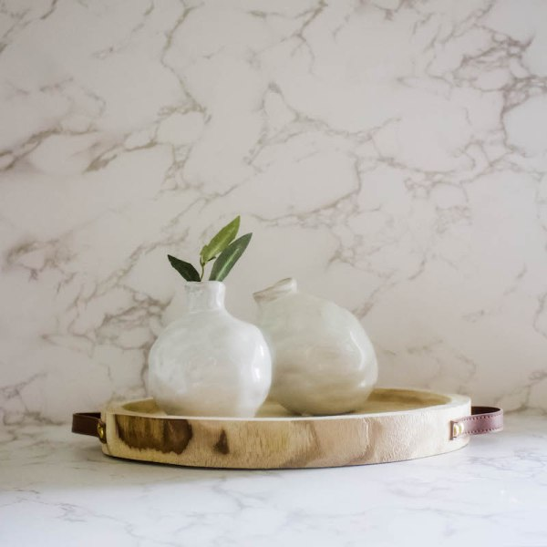 Add these ivory bud vases to your living space and refresh your home or office decor. Ceramic with a glazed ivory finish and the look of handmade, it's a unique style perfect for any space!   Designed Simple