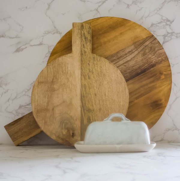 SHOP NOW - Add style & function to your kitchen with a round wood cutting board. Small or large, perfect size for kitchen display & serving. | Designed Simple