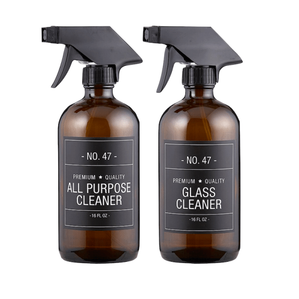 Add style to your cleaning routine with this amber glass cleaning bottle set. Each bottle features a simple and sophisticated label. Easy to refill, just add your favorite cleaning liquids!   Designed Simple