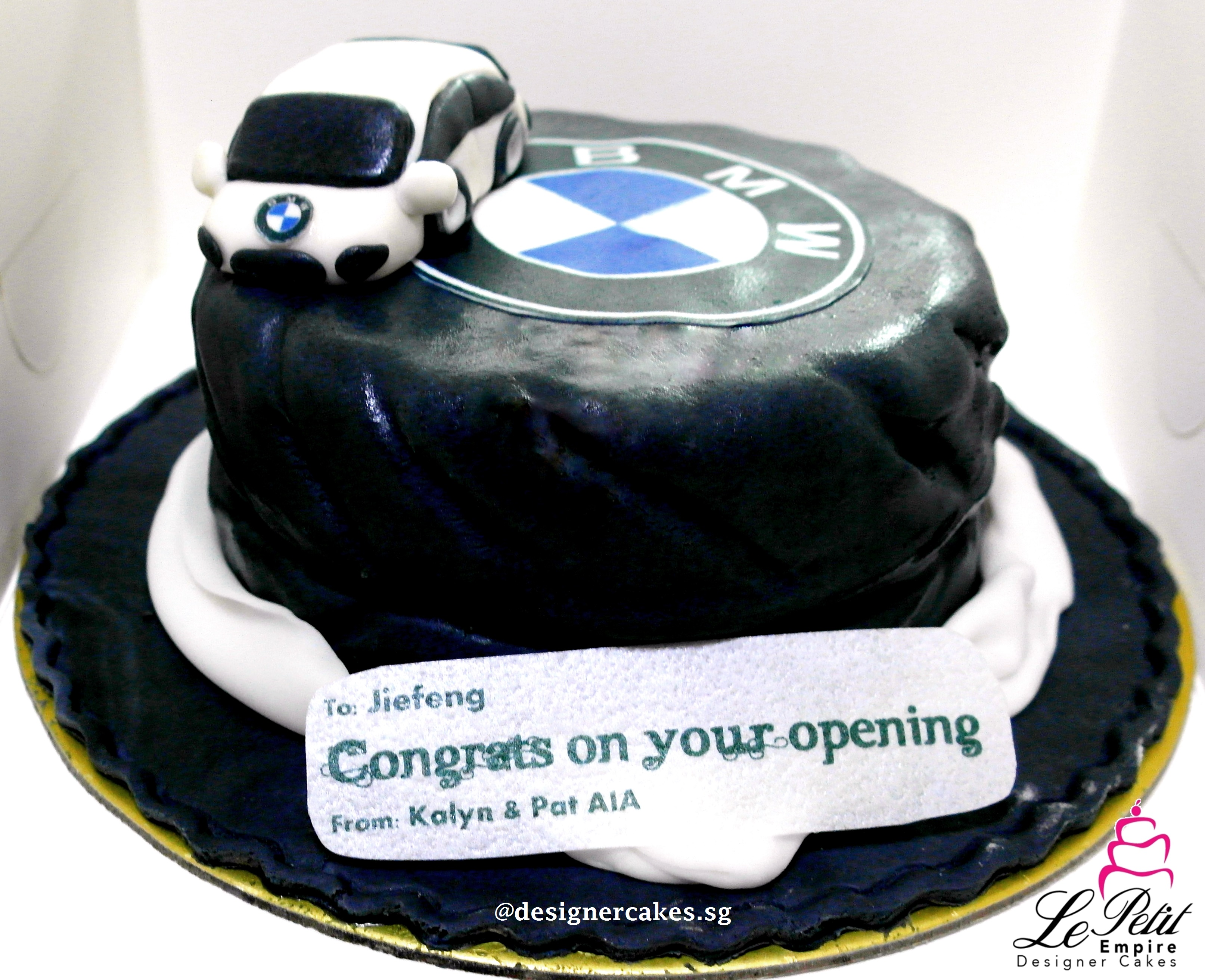 Cutomized Opening Cake, Tyre shaped cake with BMW Car on Top.