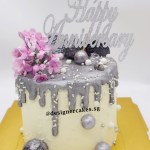 White and Silver Drip Cake With Lilac Sugar Flowers Anniversary Cake