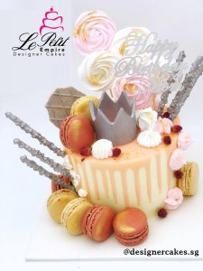 Drip Cake - Pink and white drip cake with silver crown, meringues, silver waffles and macarons. Singapore Customized Cakes