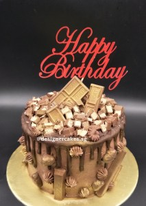 Drip Cake - Shimmer gold chocolate drip cake with chocolates. Singapore Customized Cakes