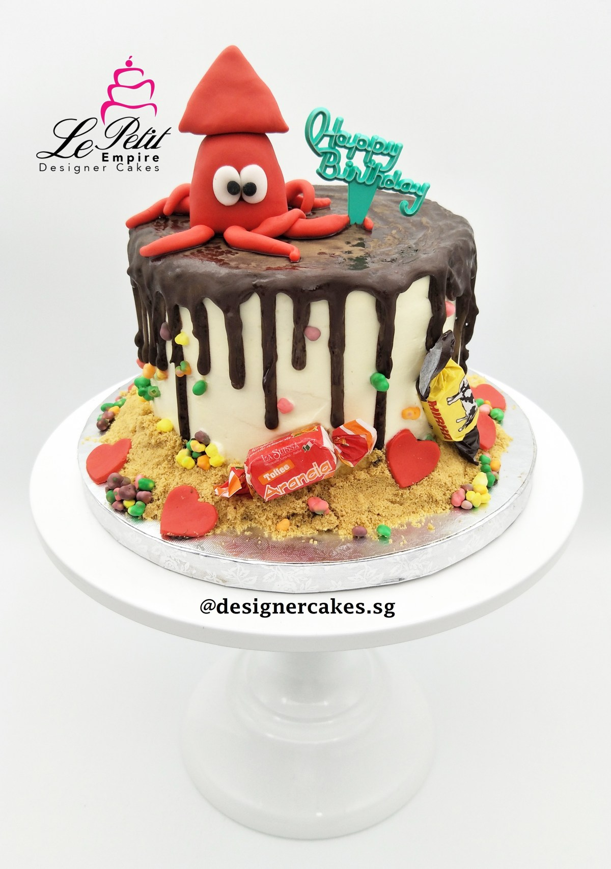 Drip Cake - Themed drip cake with fondant sotong, candies and sand. Singapore Customized Cakes