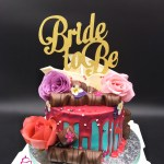 Drip Cake - Turquoise and pink drip cake with roses, chocolate, and white chocolate shards. Singapore Customized Cakes