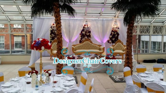 chandelier backdrop gold sofa
