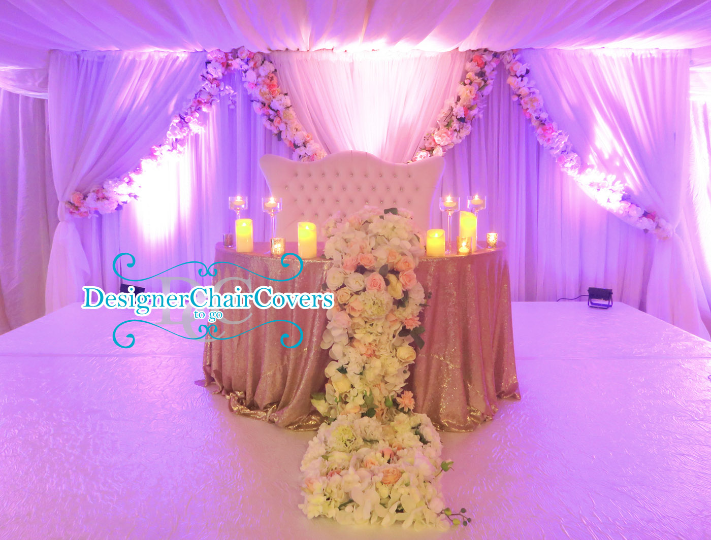 The sweetheart table with cascading flowers - Designer Chair Covers ...