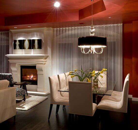 The ceiling, fireplace and dining room lighting combined make this room GLOW!