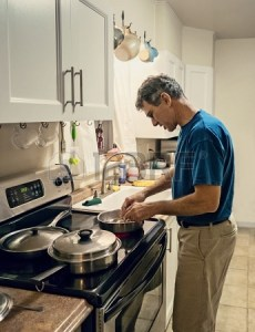 17035138-candid-lifestyle-shot-of-a-mature-man-cooking-dinner-alone-in-a-plain-small-kitchen-man-is-backlit-h