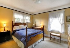 12621480-small-cozy-yellow-bedroom-with-blue-blanket-and-elegant-design