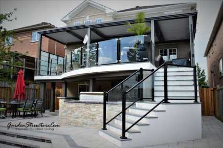 Stunning modern curved deck with large stairs.
