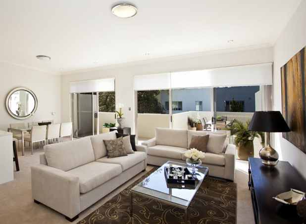 Brown sofa white rug for Brown and white living room ideas
