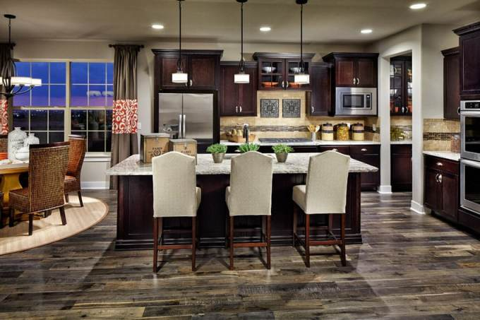 Kitchen With Dark Cabinetry And Open Plan Design