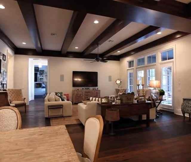 Transitional Living Room With Hardwood Flooring And Open Beams