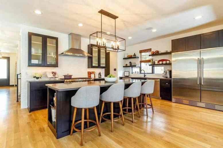 Kitchen with open shelving wall and island