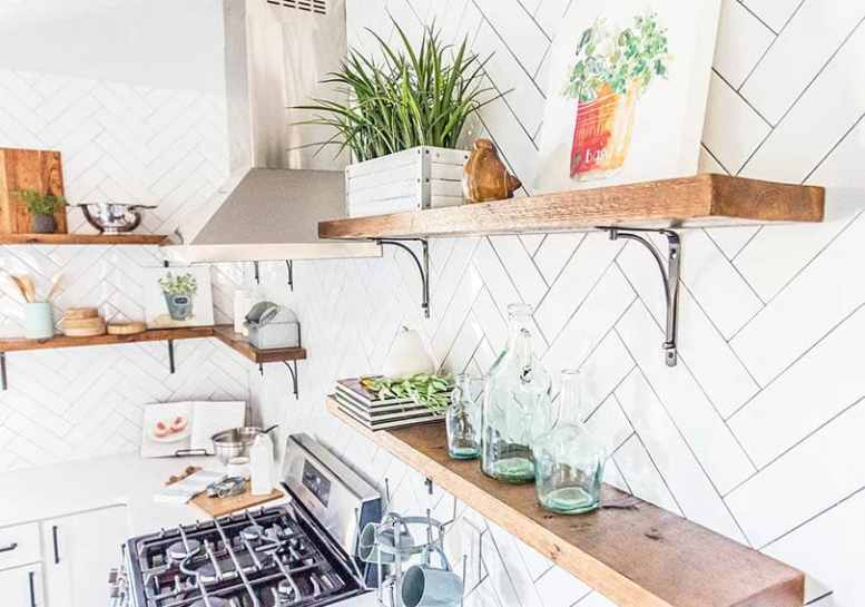 Wood open shelving in kitchen with decor items