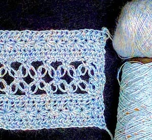 Double-stranded Lovelace swatch: sport weight Lotus and lace weight glittery mohair.