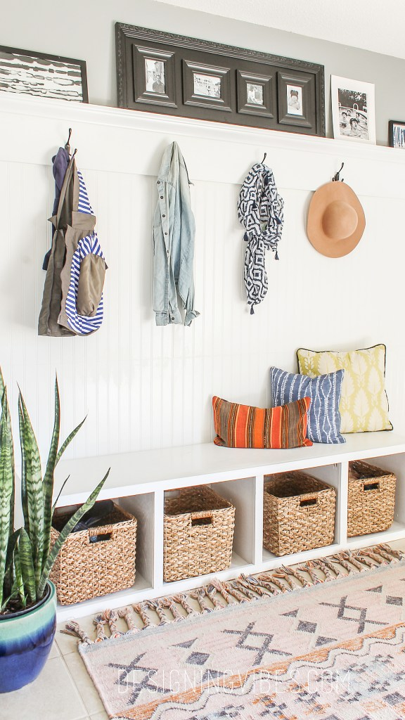 diy custom mudroom under $200. boho chic laundry room with beadboard