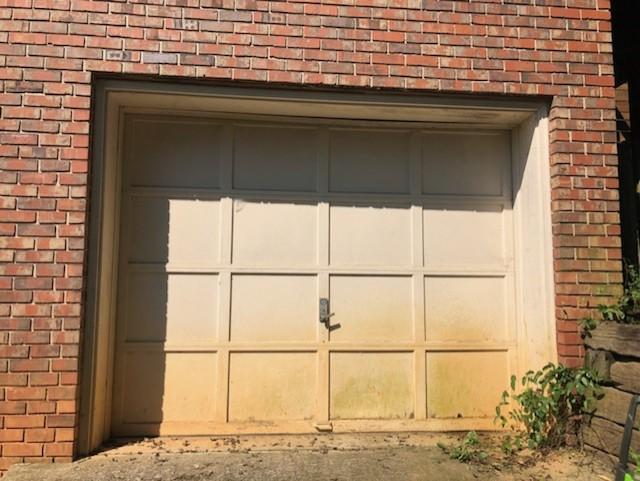 How To Paint Over A Chipped Garage Door Diy Wood Garage