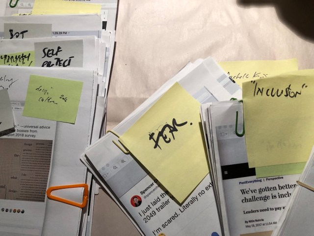 Stacks of paper with little notes atop of each one.