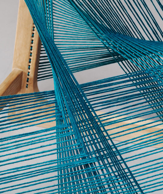 tuquoise-silk-threads-around-an-oak-frame
