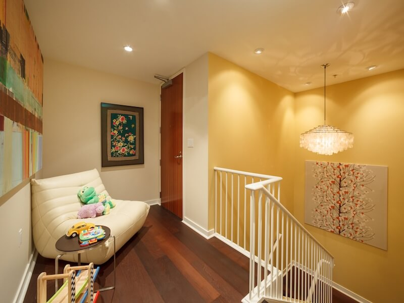 Yellow-accent-wall-and-white-stairs