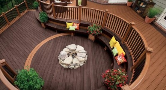Awesome-10-Decks-Designed-To-Be-Perfect-For-A-Party-with-flower-white-fireplace-stone-and-wooden-bench-yellow-red-pillow-and-white-sofa