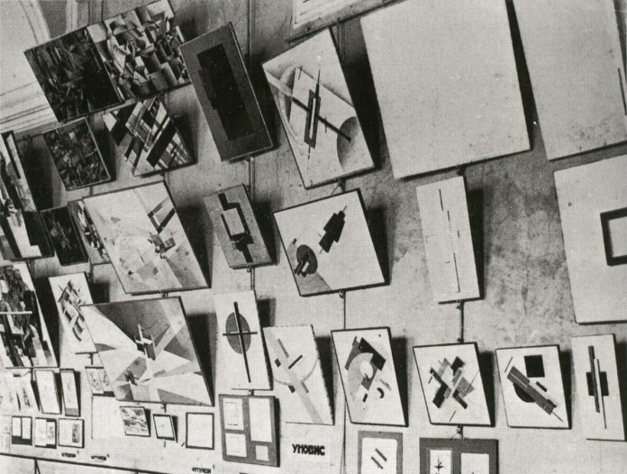 "Design Luminy UNOVIS-Exhibition-1923-""Work-by-Petrograd-Artists-Belonging-to-UNOVIS-800x605 Kasimir Malevitch – Manifeste suprématiste UNOVIS – 1924 Histoire du design Références Textes  Suprématisme Manifeste Malevitch Futurisme"
