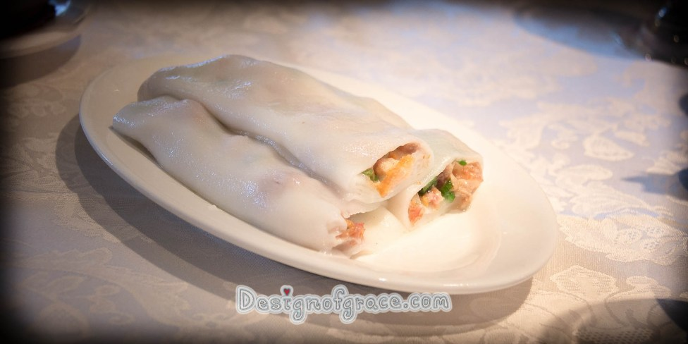3 pieces of steamed rice roll filled with Shirmp on a white plate