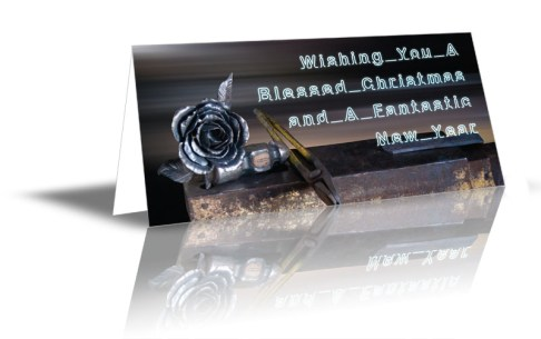 """Metal Flower design saying """"Wishing You A Blessed Christmas and A Fantastic New Year!"""""""