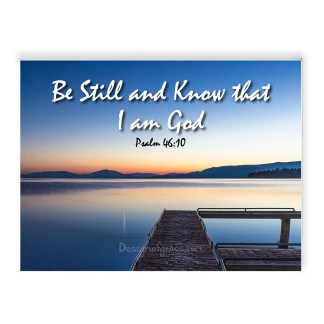 """Still waters at Flathead Lake Jetty at sunset with orange and blue colours , Montana, USA with the text """" Be Still and Know that I am God,Psalm 46:10"""""""