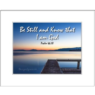 "Still waters at Flathead Lake Jetty at sunset with orange and blue colours , Montana, USA  with the text "" Be Still and Know that I am God, Psalm 46:10"""