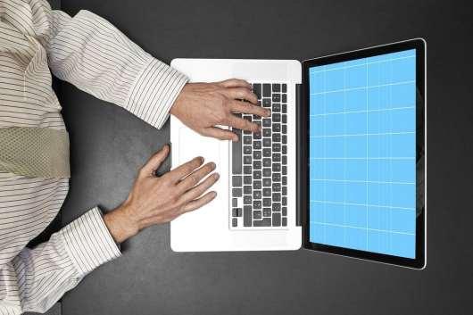 Hands-On Laptop Mockup