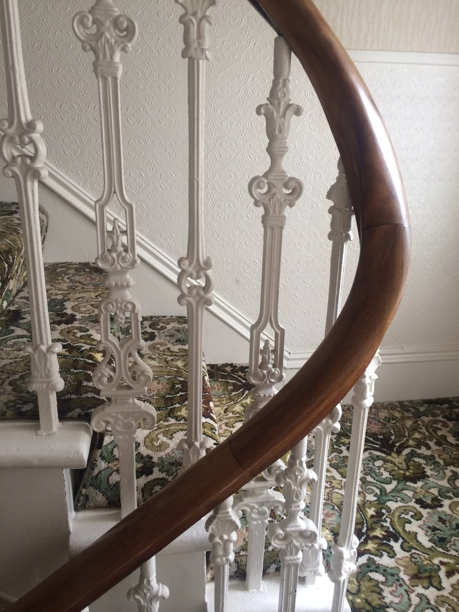 hallway renovation cast iron balustrade before