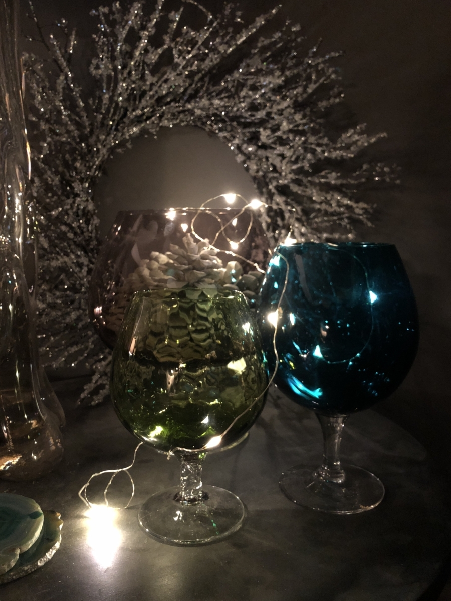 Charity store vases filled with LED wire lights