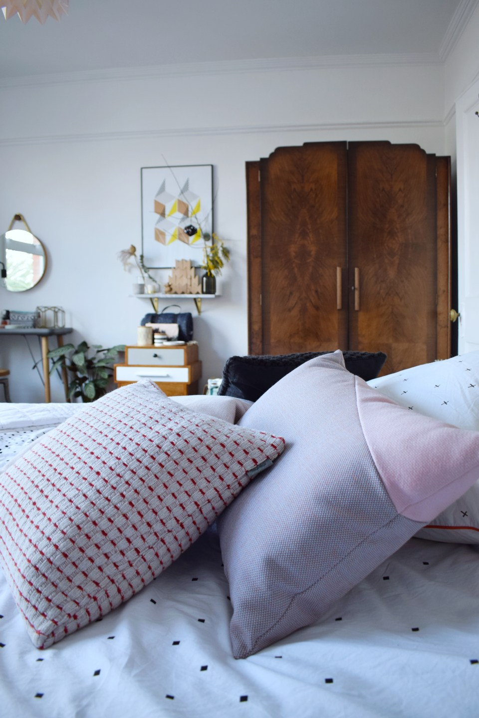 ideas and inspiration home decor - Scandinavian bohemian white and soft tones natural elements bedroom pastel pillows and vintage inlaid wood wardrobe (2)