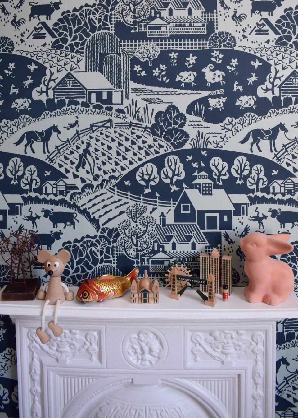Farrow Ball Gable wallpaper interior ideas, childrens room decor with a scandi monochrome scheme, wooden toys, vintage toys