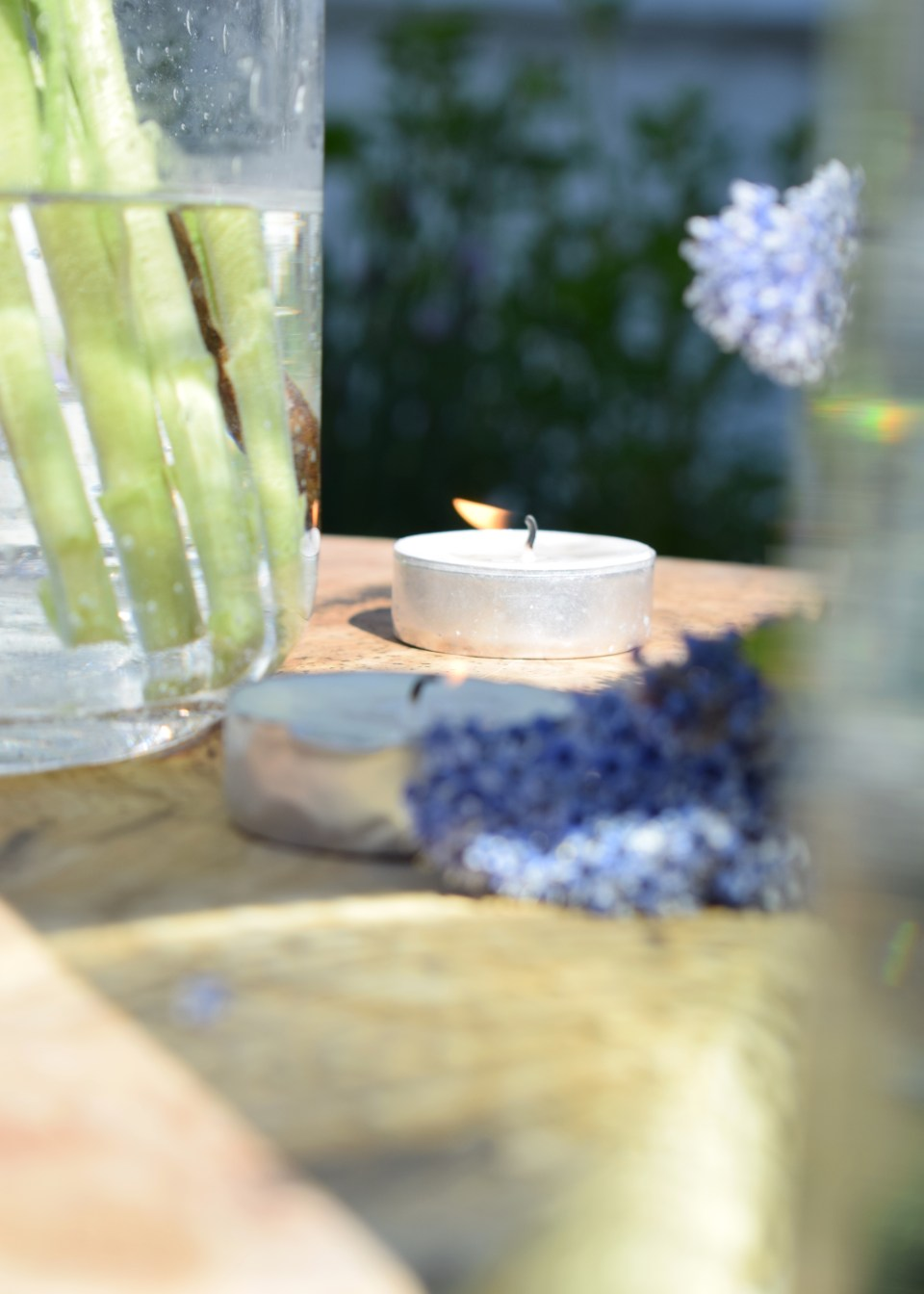 ideas and inspiration for outdoor dining, rustic tealights and wood
