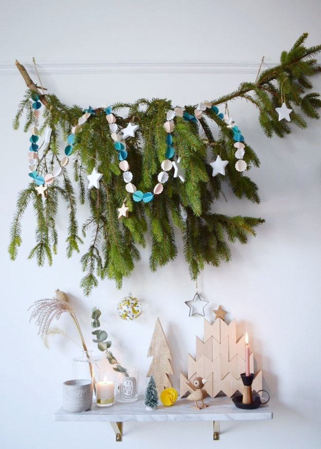 decorated-pine-branch-instead-of-small-chritmas-tree-scandinavian-styling-hay-wood-blocks-Rosendahl-bird-pia-cloud-garland-white-interior-1 (2)