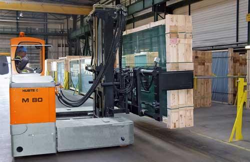 HUBTEX M 80 Electric Multidirectional Sideloader transporting glass packs