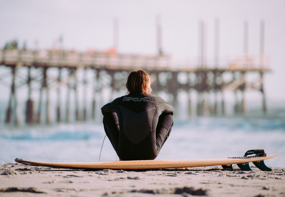 This photo of a surfer is made more interesting by adding depth between the subject and the background.